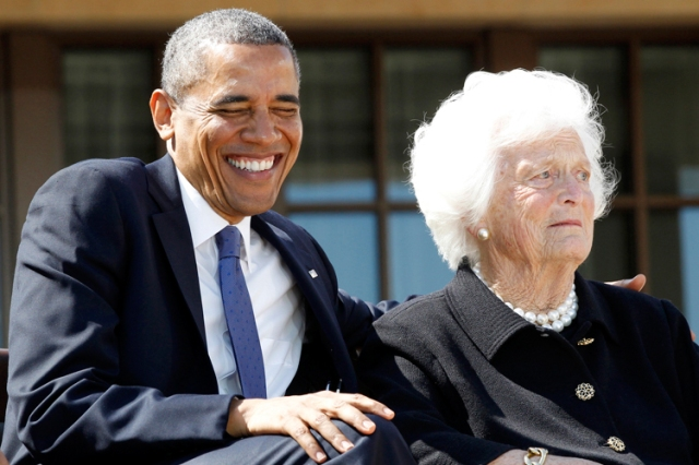 U.S. President Barack Obama laughs alongside former first lady Barbara Bush during the dedication ceremony for the George W. Bush Presidential Center in Dallas